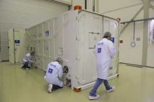 Technicians opening the Galileo Container