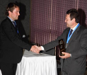 Carlo des Dorides, Executive Director of the GSA, presents first prize to Daniel Hege