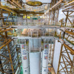Ariane 5's vehicle equipment bay is lowered for installation