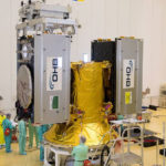 Two of the four Galileo satellites are shown being installed on their dispenser system.